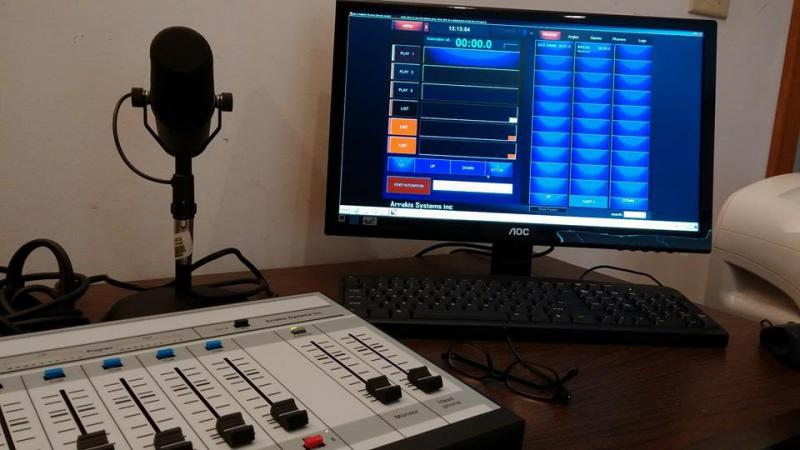Photo of audio equipment including microphone and computer screen