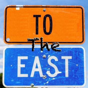 To the East street signs logo photo